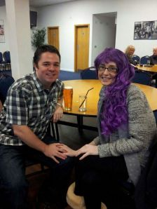 Katie looking fabulous in her purple wig with husband Stuart